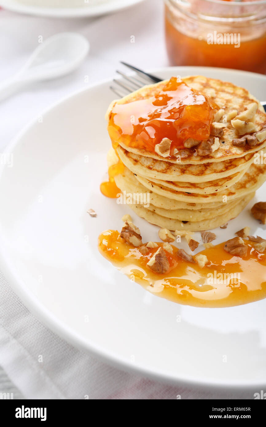 Pancakes with apricot jam, food - Stock Image