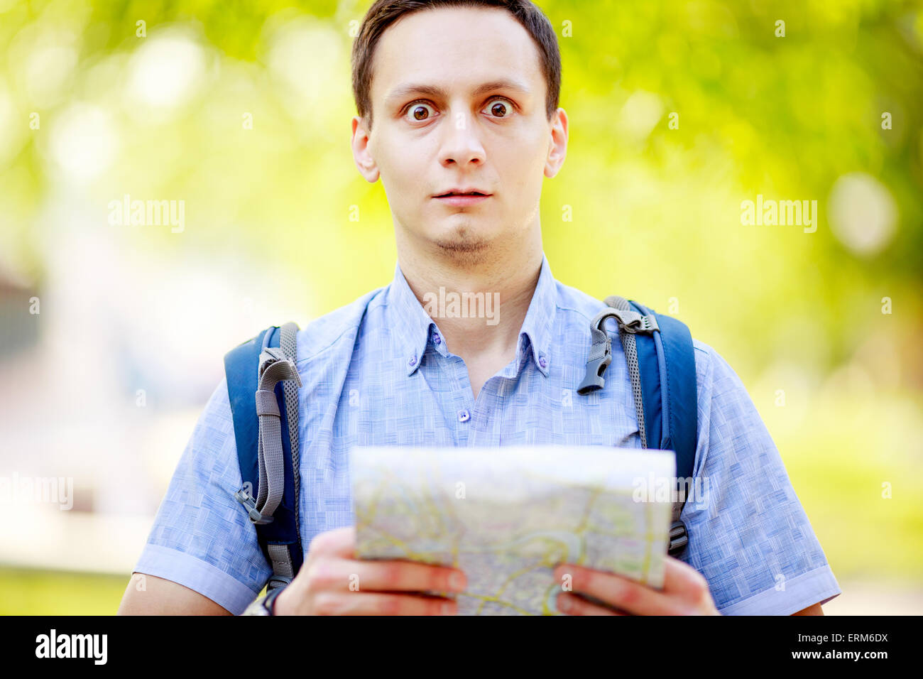 Tourist with map. - Stock Image