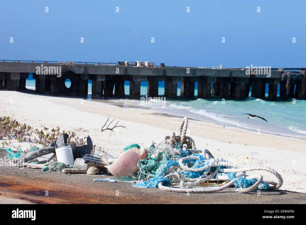 Plastic marine debris, ropes and nets collected from beach for shipping off-island and disposal. - Stock Image