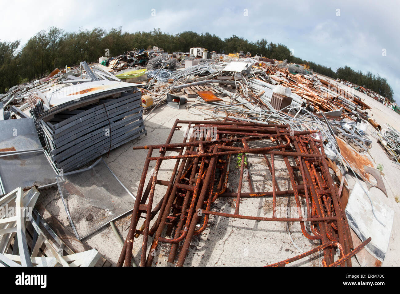 Junkyard of discarded items to be cut up and shipped off a remote North Pacific island as scrap - Stock Image