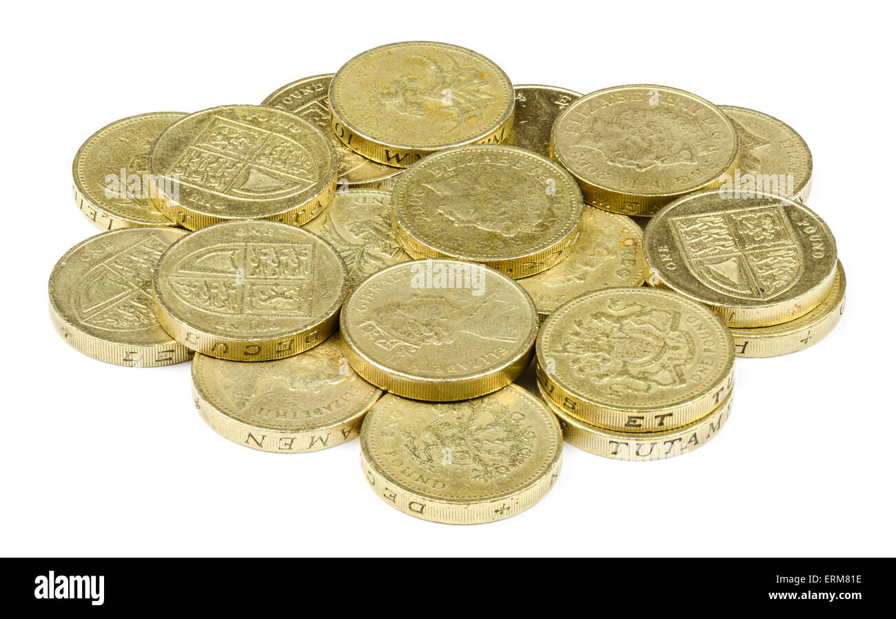 Pile of £1 coins, the currency in the UK, on a white background. - Stock Image