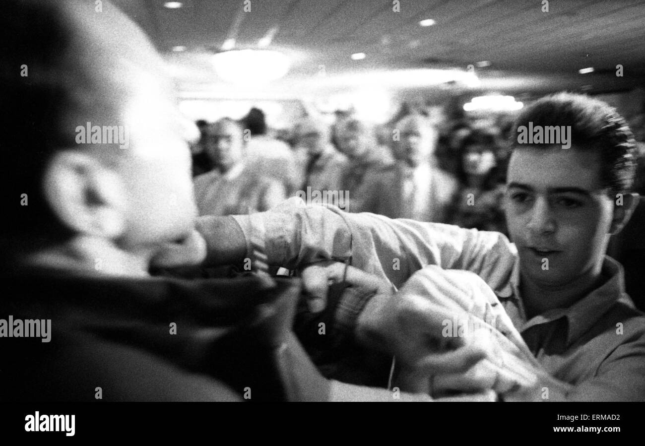Niles Township, Illinois, USA, 4th October, 1988. A fight breaks at the Michael Dukakis campaign rally. Credit: - Stock Image