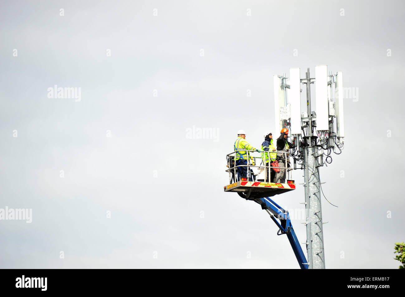 Technicians work on a mobile telephone tower in Bristol. Stock Photo