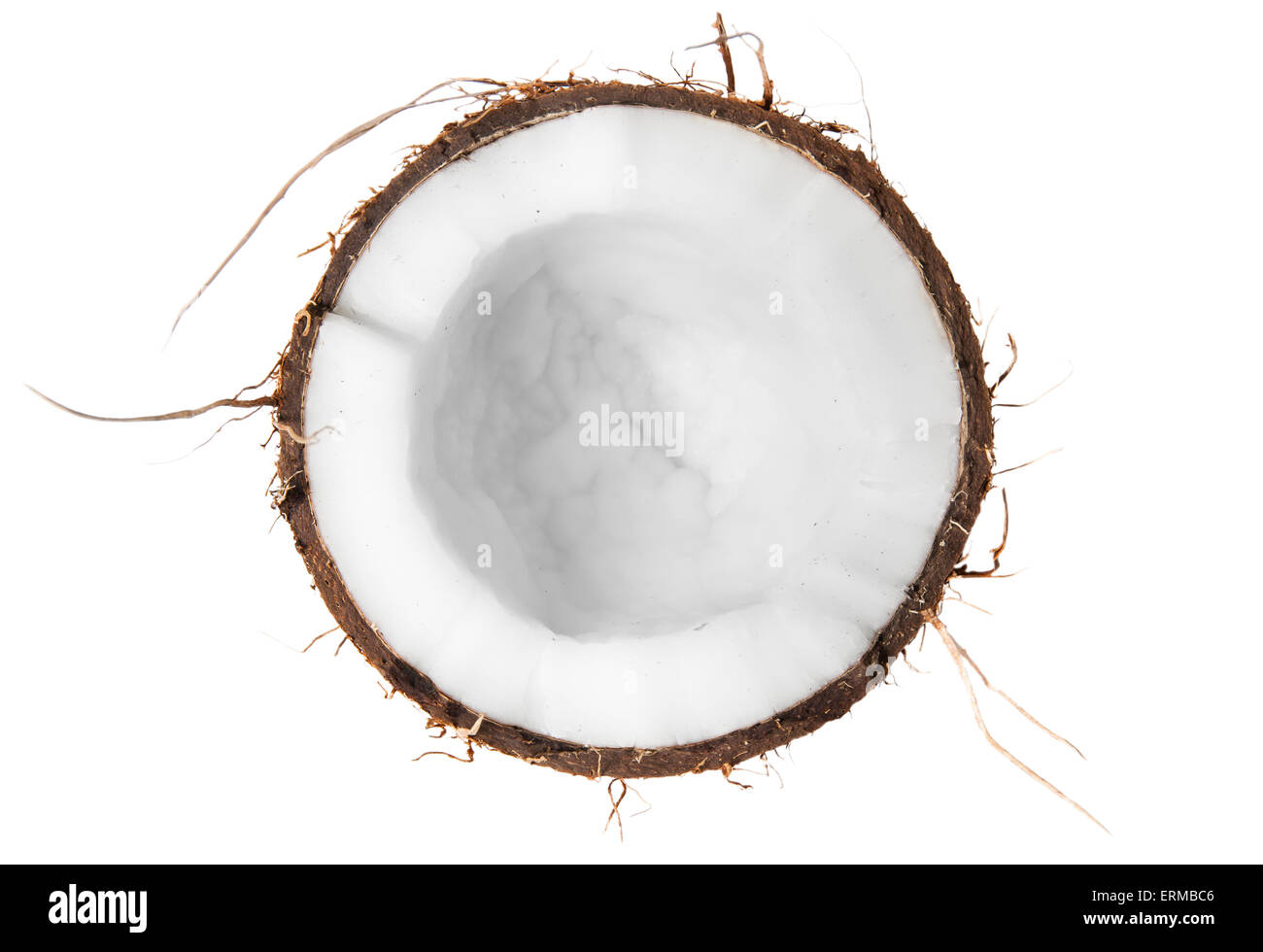 Half of coconut top view isolated on white background - Stock Image