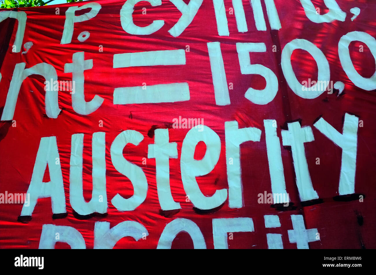 A giant red and white Austerity protest banner held up during an anti-austerity demonstration in Bristol. - Stock Image