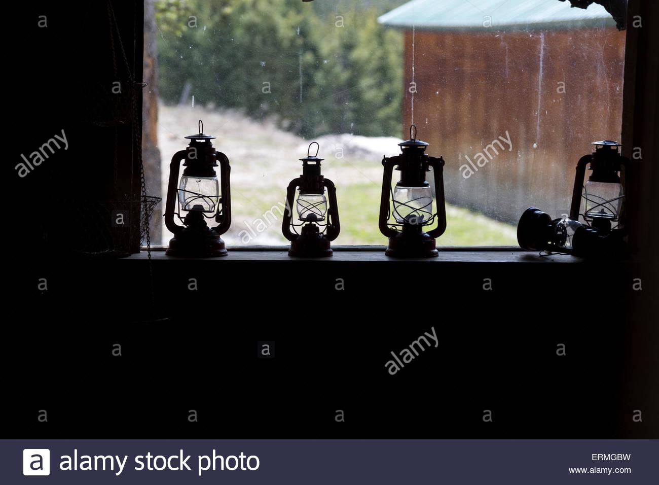 Kerosene Lantern on Window Sill - Stock Image