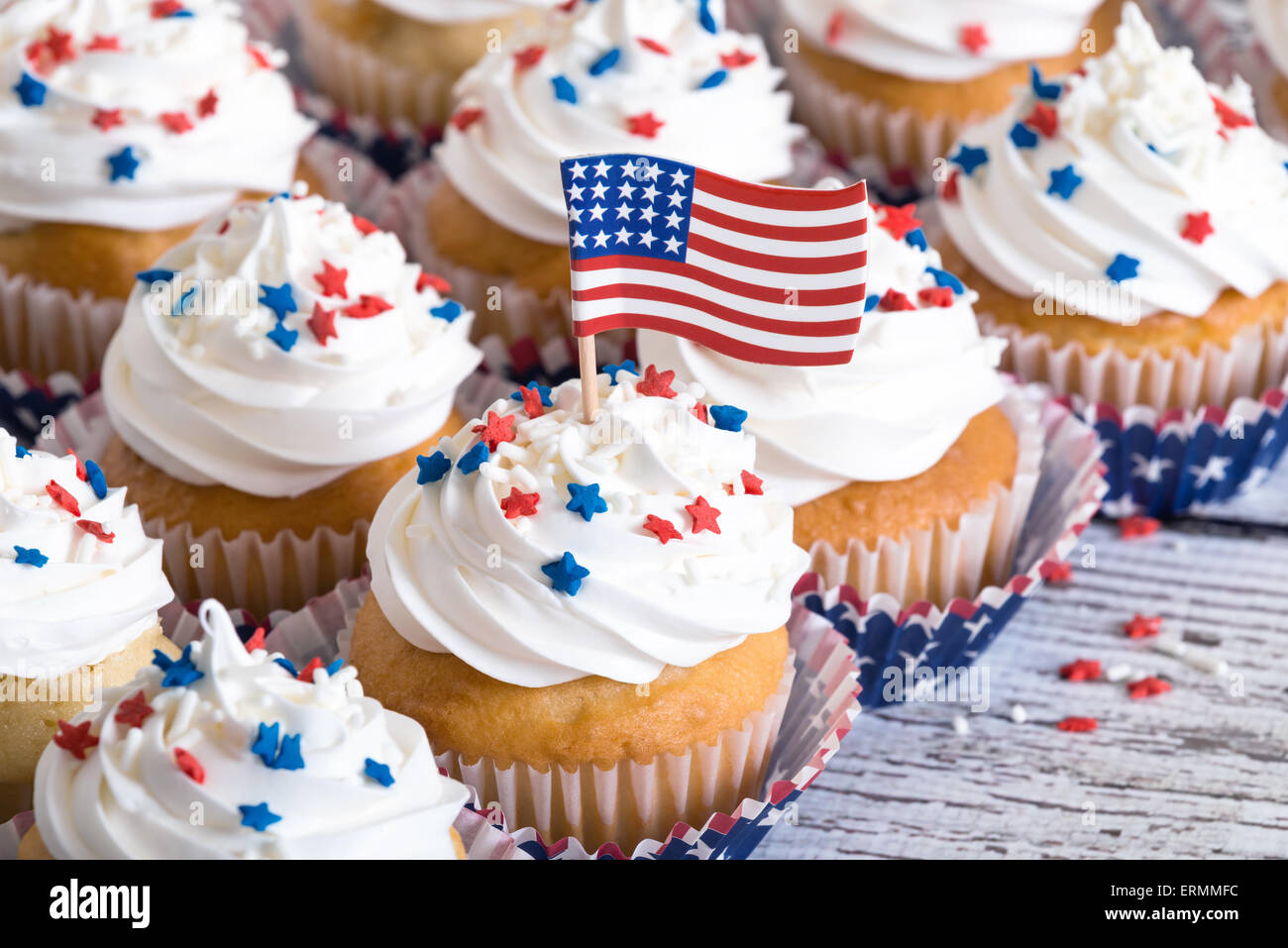 Patriotic cupcakes with sprinkles and American flag Stock