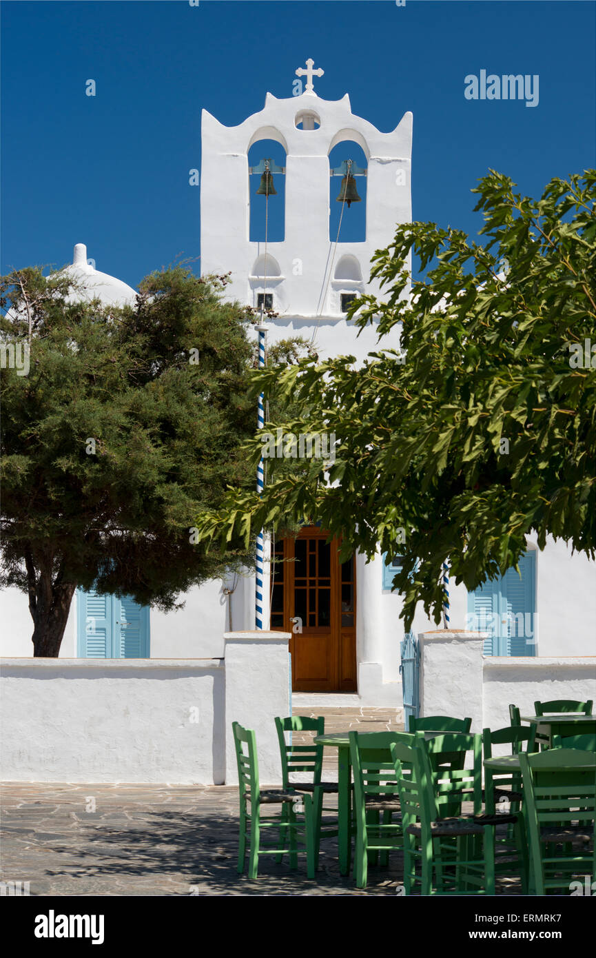Wooden taverna chairs in front of the the church of Agios Konstantinos; Artemonas, Sifnos, Cyclades, Greek Islands, - Stock Image