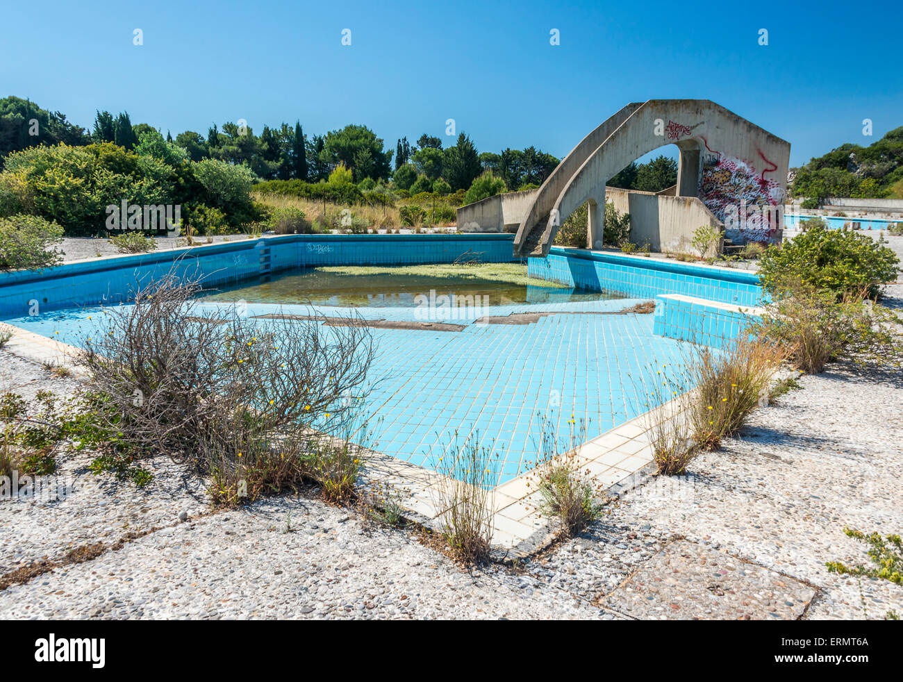 an abandoned lido complex on the island of rhodes in Greece where the swimming pools have filled with rain water - Stock Image