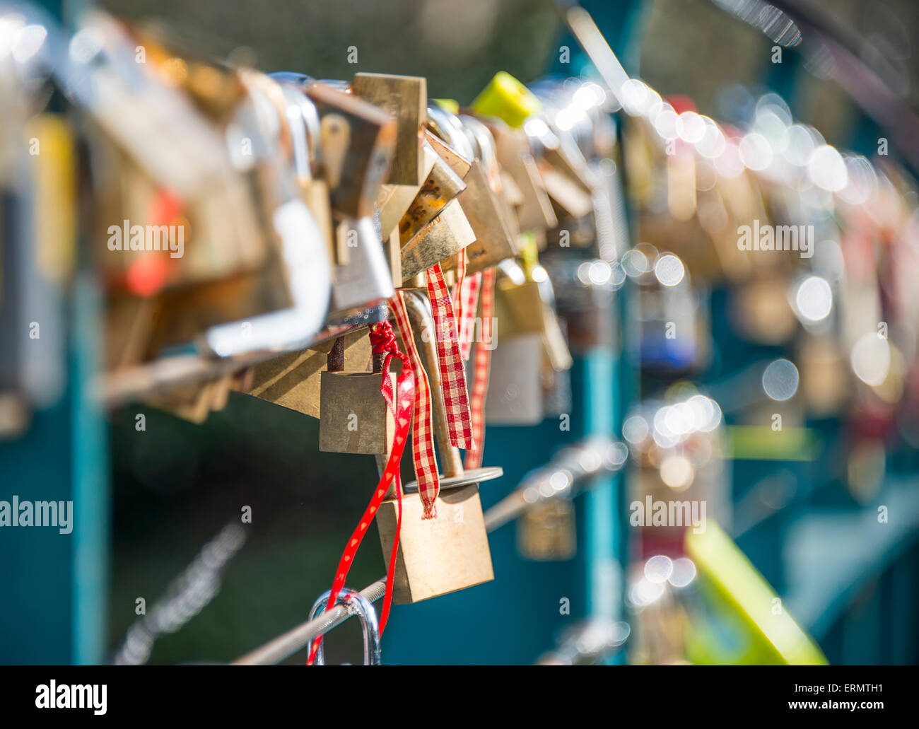 Padlocks inscribed with couples vows of love attached to a bridge in Bakewell, Derbyshire - Stock Image