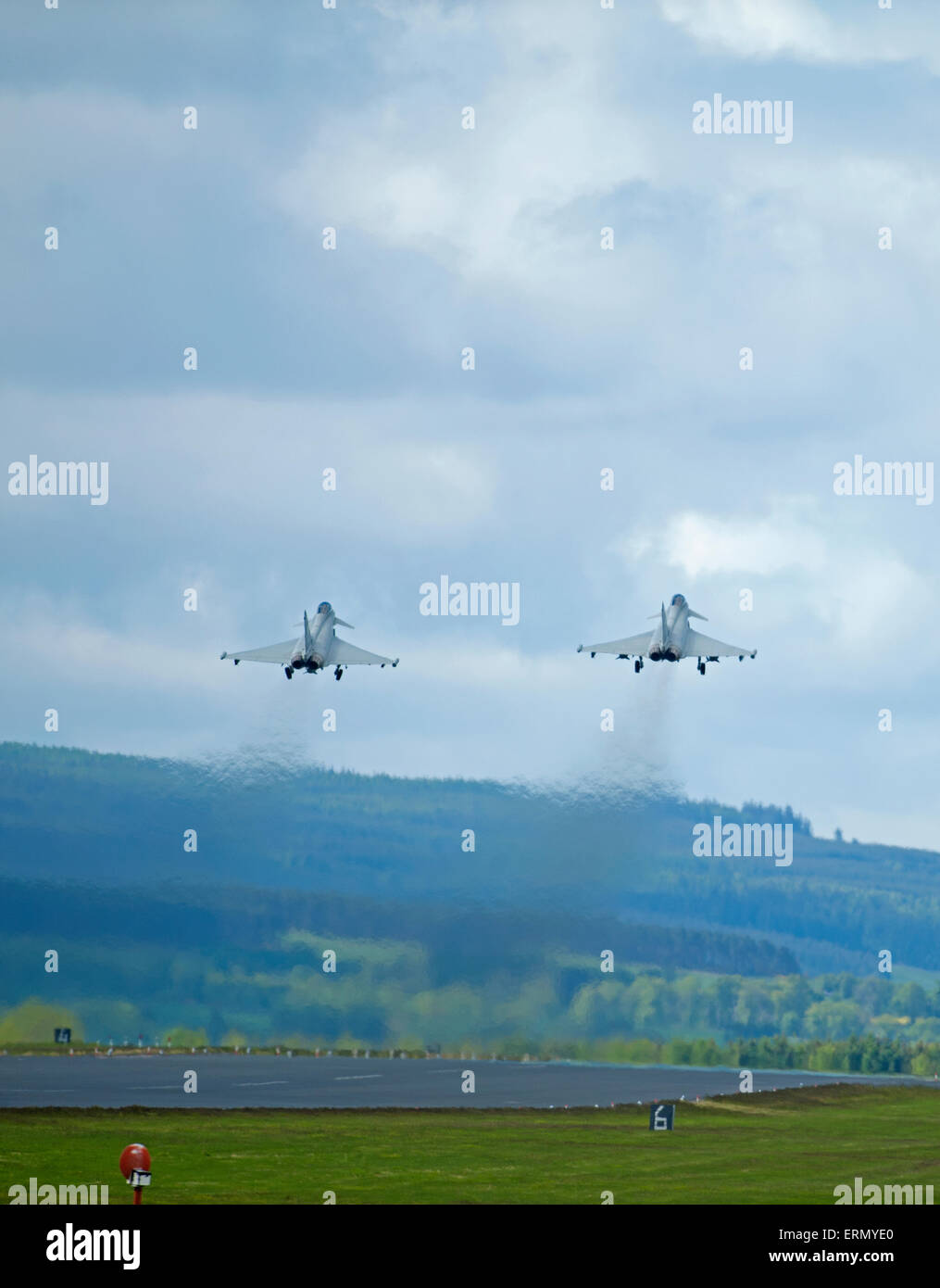 Paired take off,  Eurofighter Typhoon fast fighter jet departs RAF Lossiemouth home base in Scotland.  SCO 9850. - Stock Image