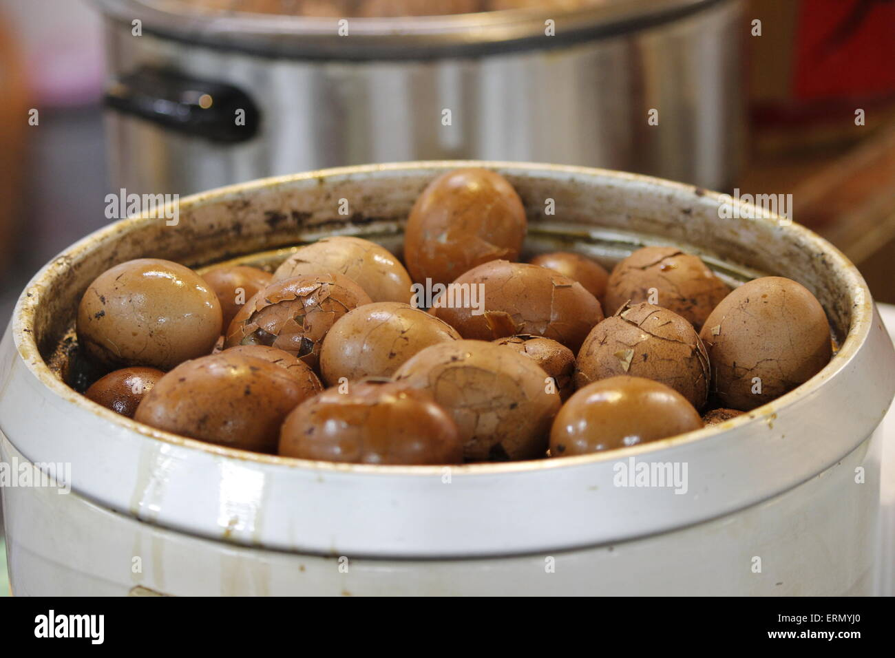 tea leaf eggs in cooking pot - Stock Image