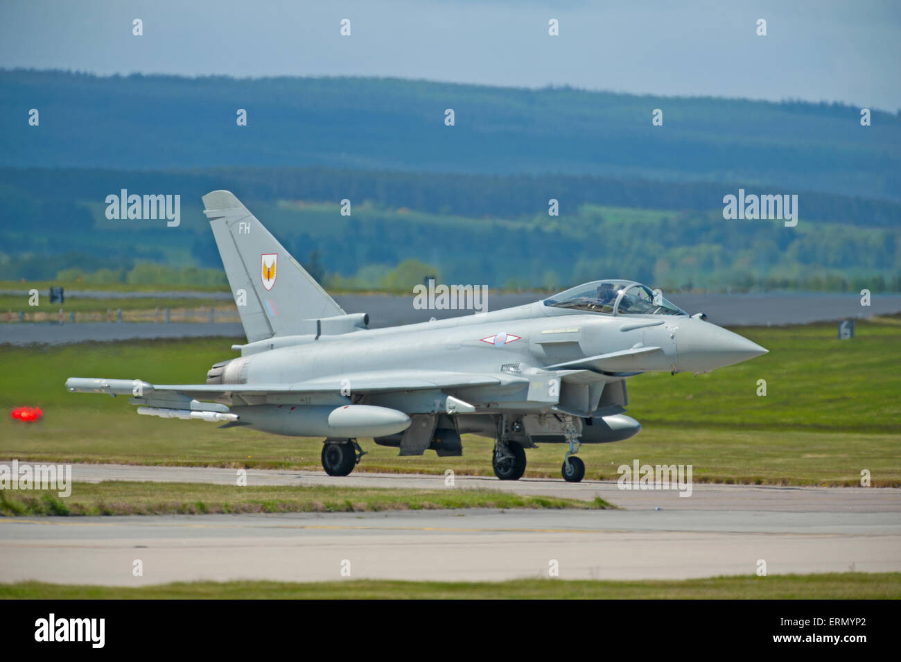 Eurofighter Typhoon fast fighter jet preparing to take off from RAF Lossiemouth home base in Scotland.  SCO 9852. - Stock Image