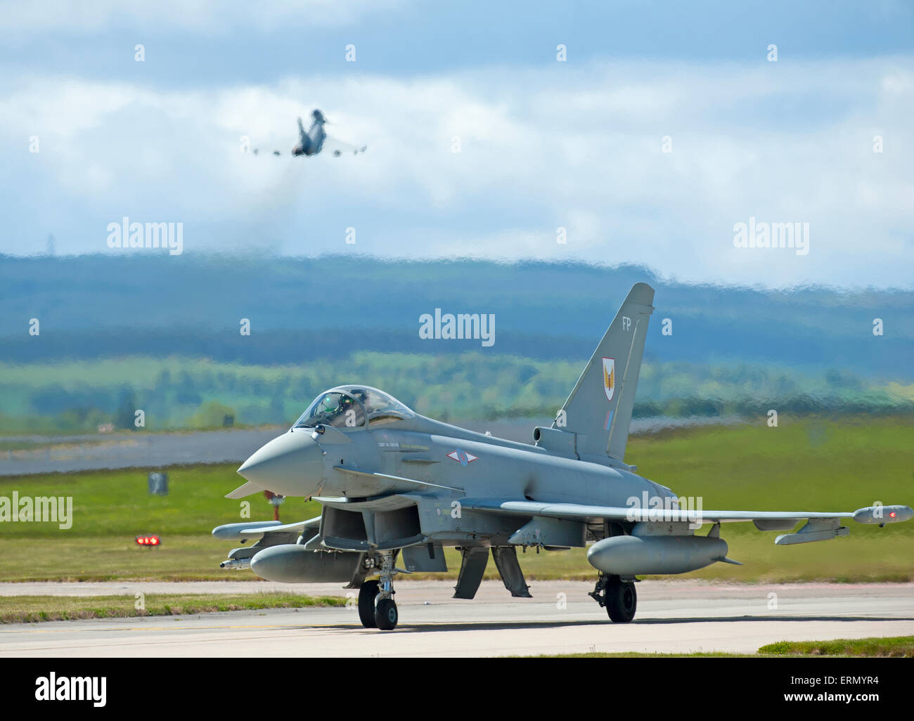 Eurofighter Typhoon fast fighter jet preparing to take off from RAF Lossiemouth home base in Scotland.  SCO 9854. - Stock Image