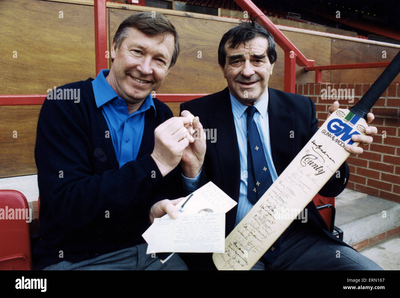 Manchester United manager Alex Ferguson with veteran cricketer Fred Truman at Old Trafford, posing with an autographed - Stock Image