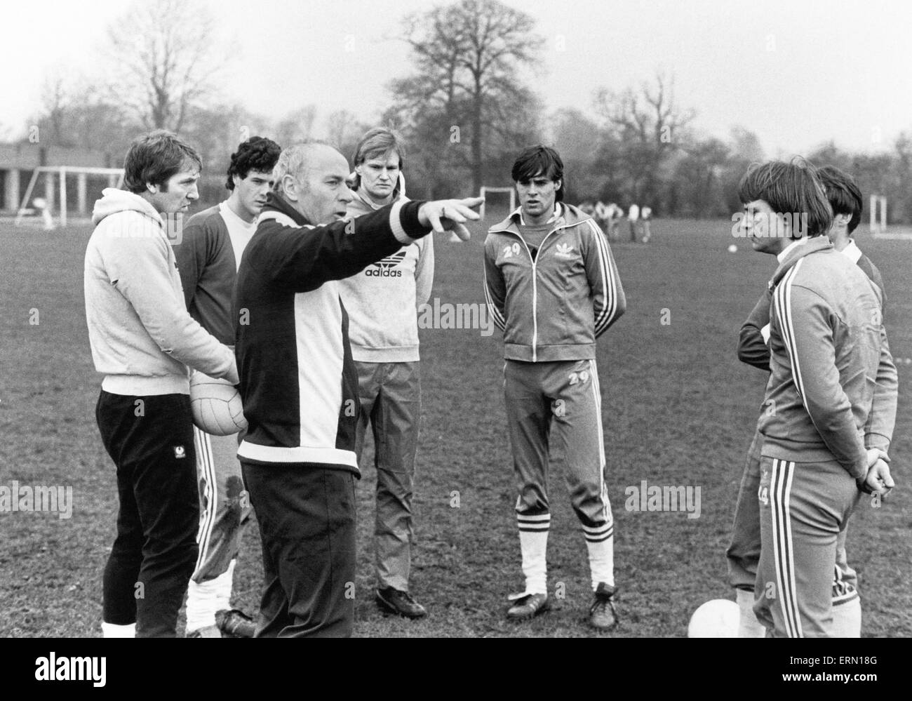 Birmingham City football manager Ron Saunders gets down to work with his players  at the club's Elmdon training - Stock Image