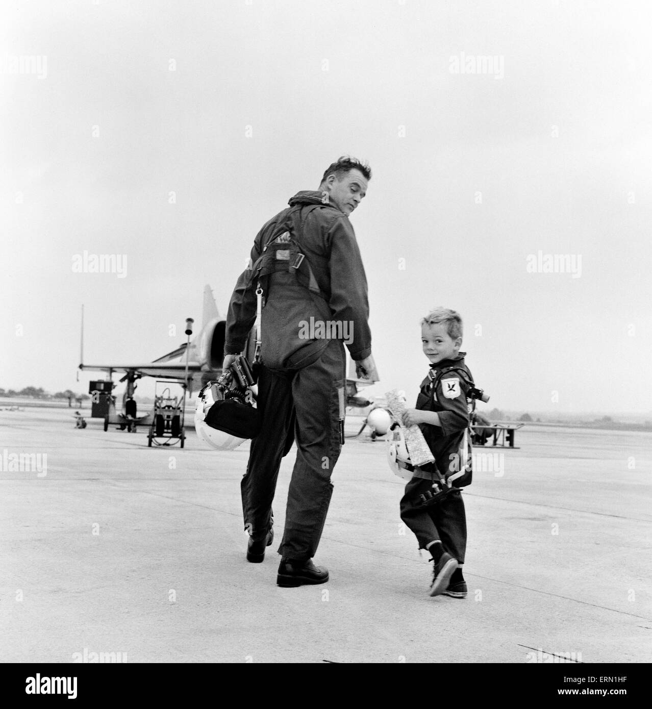 Lieutenant Commander Peter Marshall of the Fleet Air arm with his four year old son Richard. 13th August 1968. - Stock Image