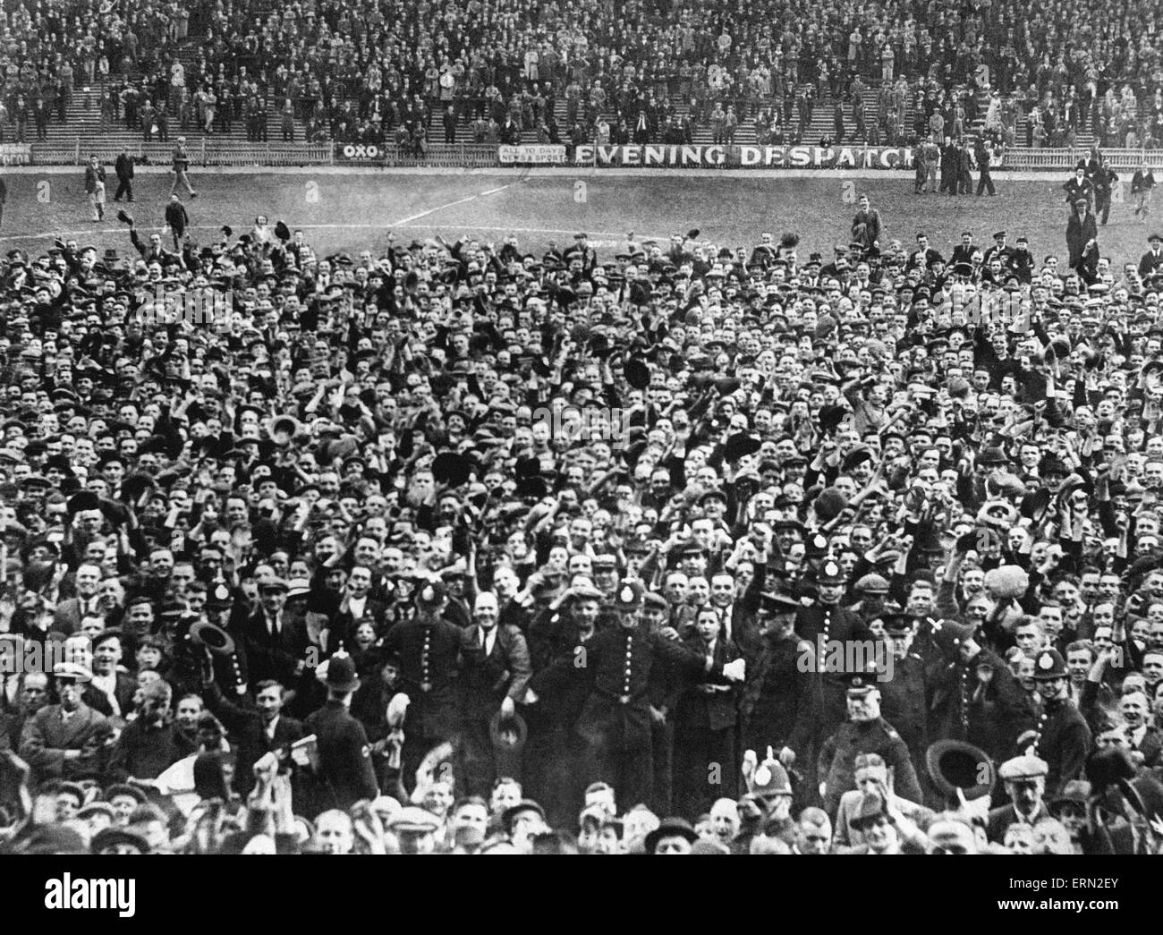 Crowd on the field at the end of Joe Bradford's last match for the club, 1935. Stock Photo