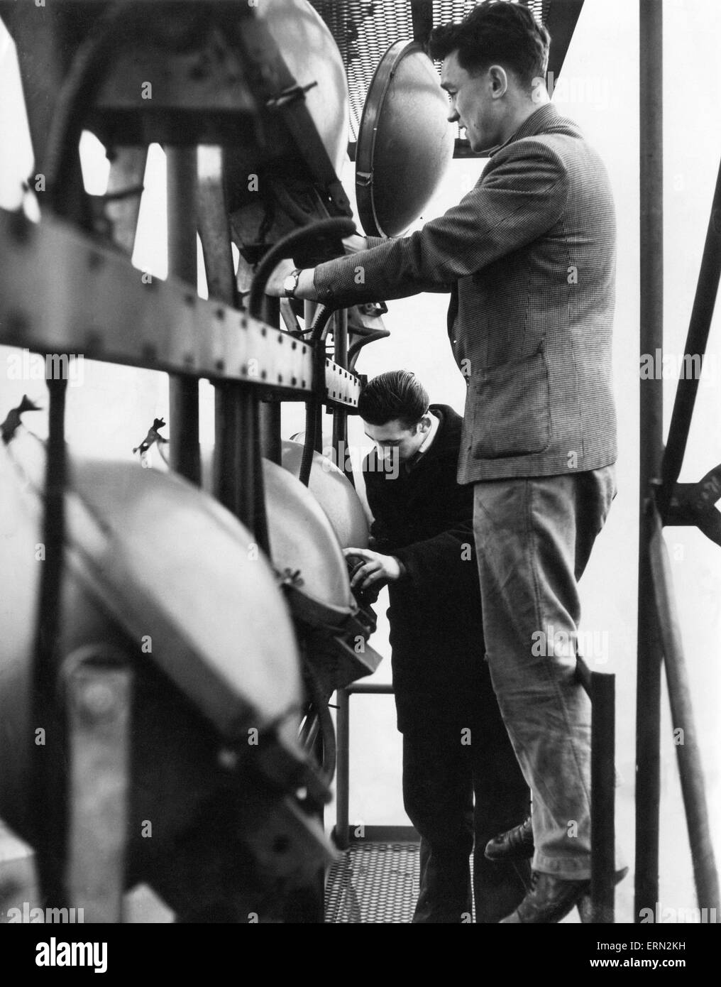 Electricians checking the lights in one of the 114ft floodlight towers at St Andrews, home ground of Birmingham - Stock Image