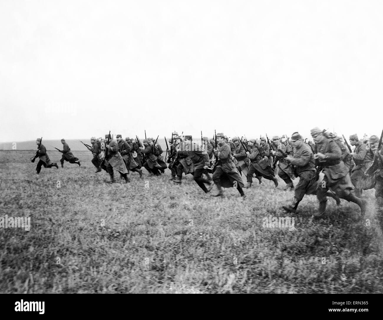 World War I French Soldiers charge across a field with rifles raised circa 1916 - Stock Image
