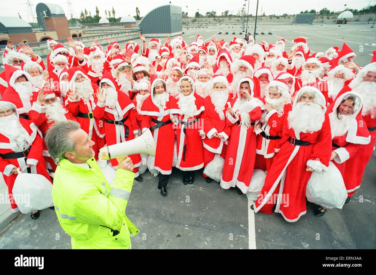 100 Father Christmas's, Photocall to open new multi storey carpark at Lakeside Shopping Centre, 14th October - Stock Image