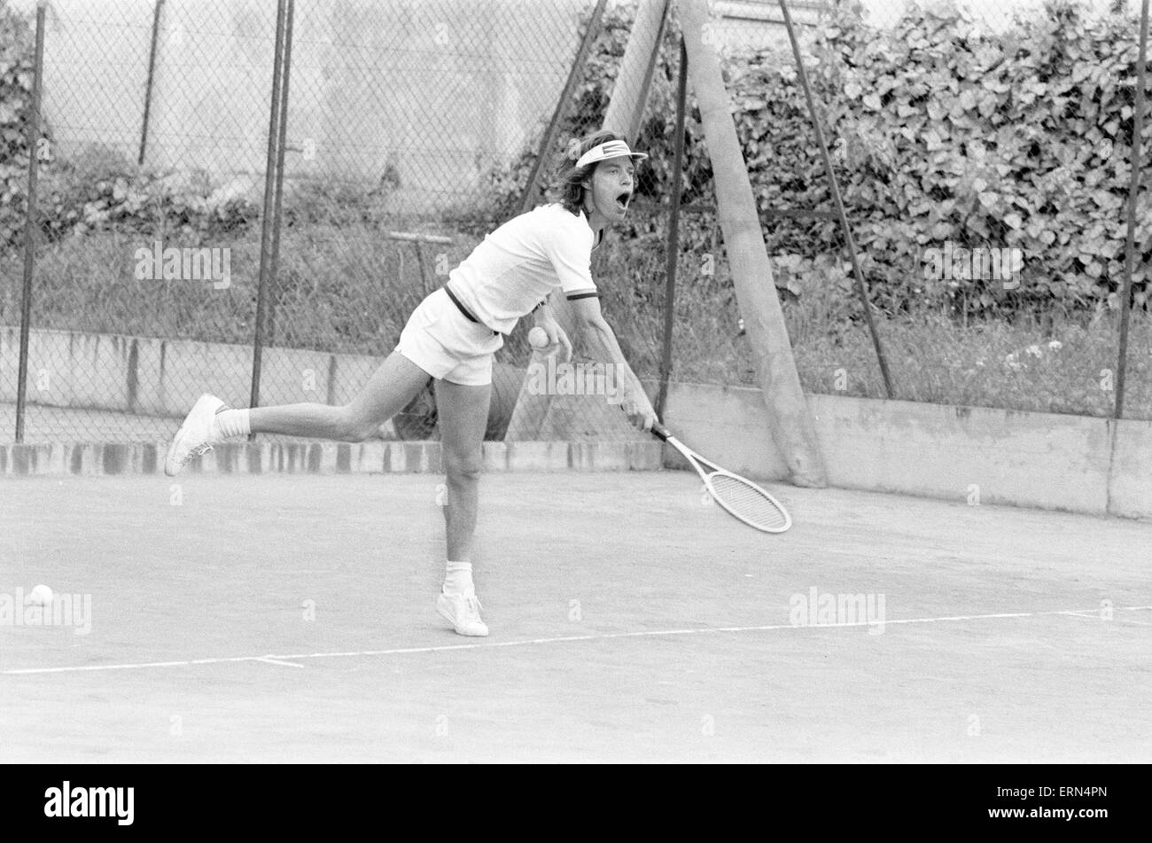 Mick Jagger and Ron Wood, takes time out to relax in the South of France, by playing tennis, before the start of Stock Photo