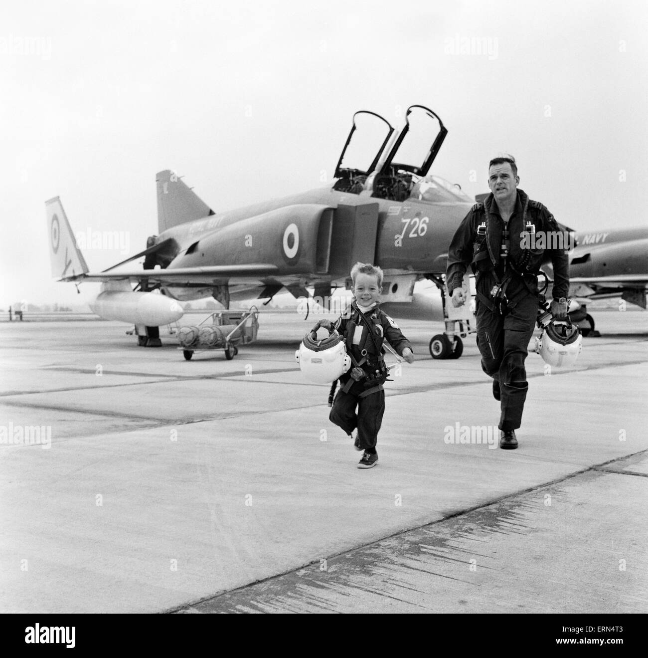 Phantom pilot Lieutenant Commander Peter Marshall of the Fleet Air arm, with his four year old son Richard dressed - Stock Image