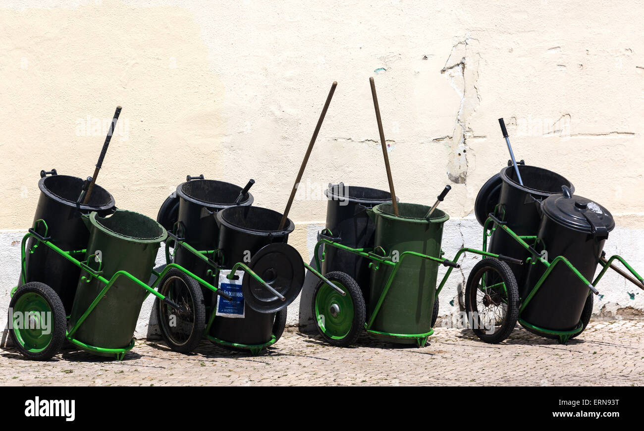 Street cleaners bins. Lisbon Portugal - Stock Image