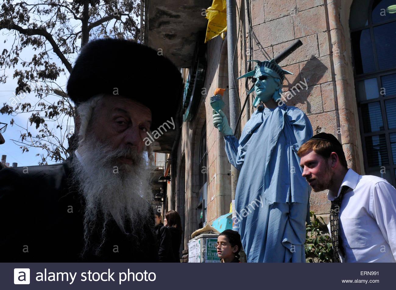Ultra-Orthodox Jews in the street of Jerusalem's Mea Shearim neighborhood. Purim is a celebration of the Jews' salvation Stock Photo