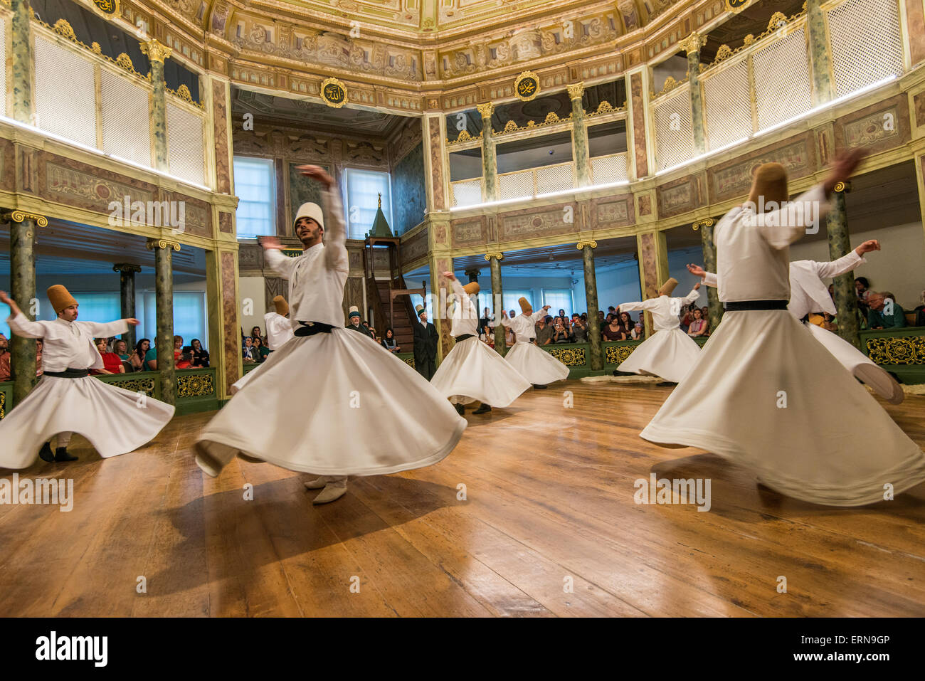 Whirling dervishes performing at Galata Mevlevi Museum, Istanbul, Turkey - Stock Image