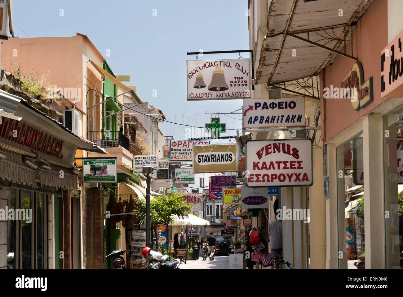 Signs in greek language on the shops in a street in Chios on the isle of Chios, Greece - Stock Image