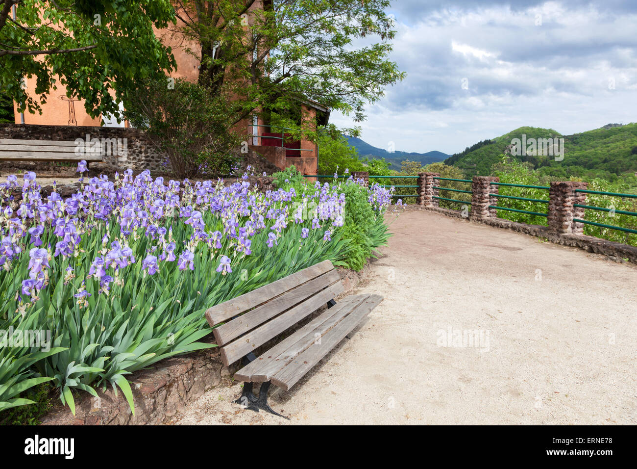 Wooden bench at the viewpoint in village Thueyts of the Ardeche Region in southern France - Stock Image