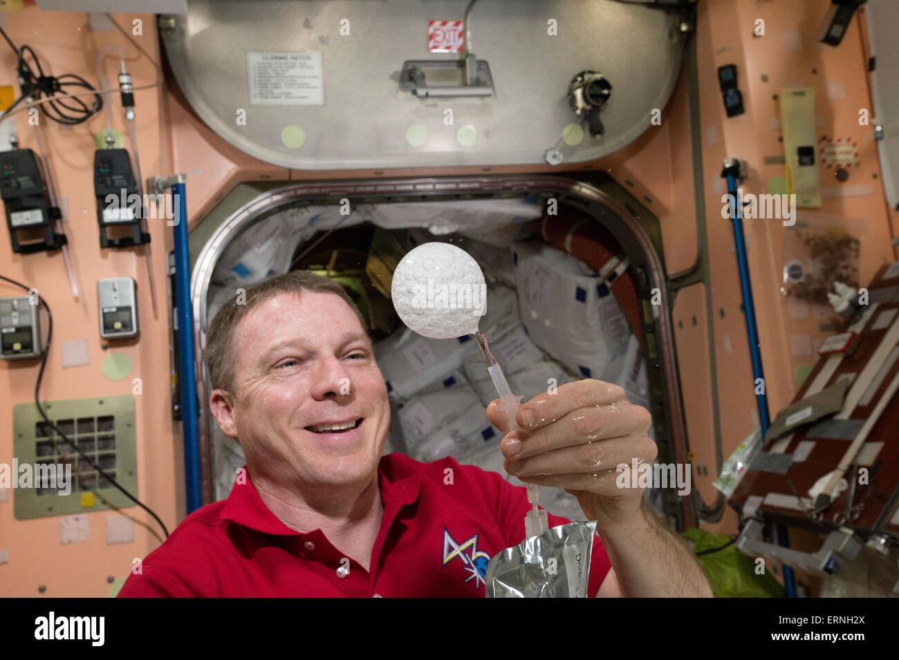 International Space Station Expedition 43 commander and NASA astronaut Terry Virts creates a sphere of bubbles in - Stock Image