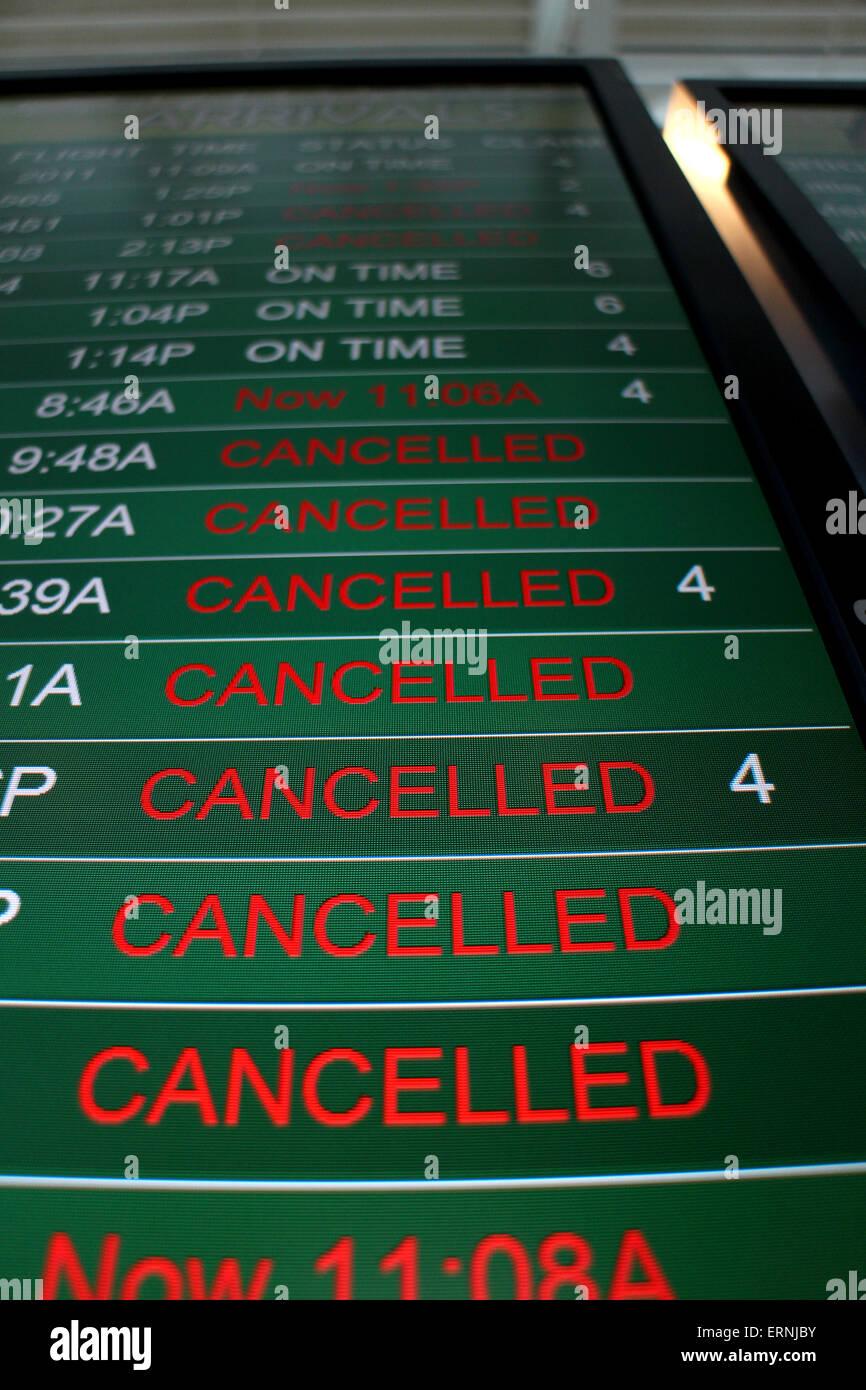Canceled flights on airport flight status board Cincinnati - Stock Image