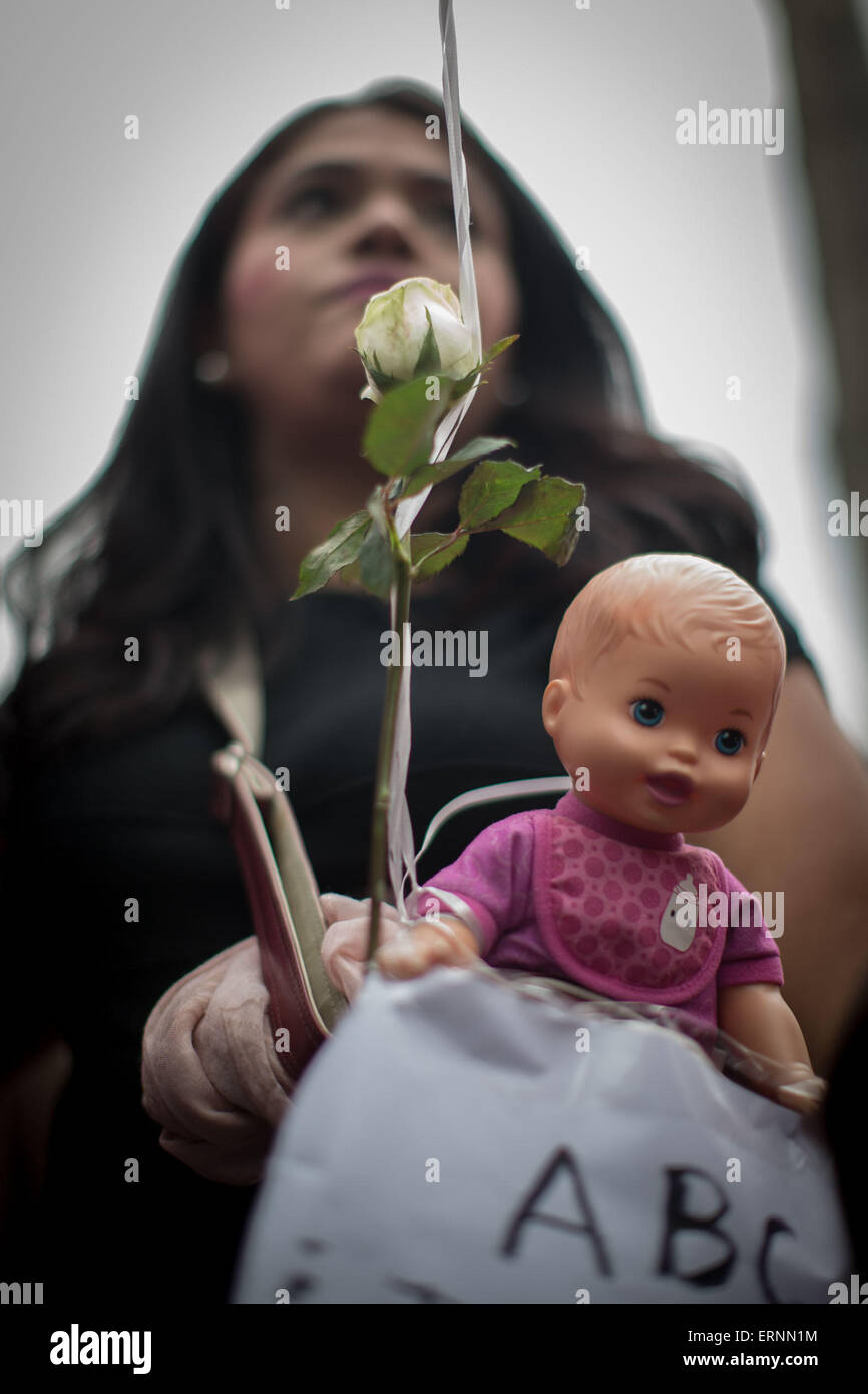 Mexico City, Mexico. 5th June, 2015. A woman takes part in a march in commemoration of the 6th anniversary of the Stock Photo