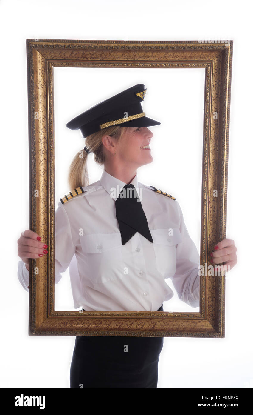 Frame and portrait of a female airline pilot in uniform - Stock Image