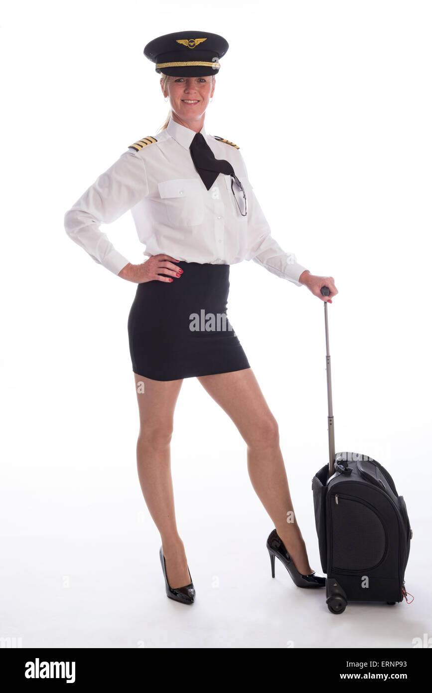 Attractive mid age female airline pilot standing in uniform