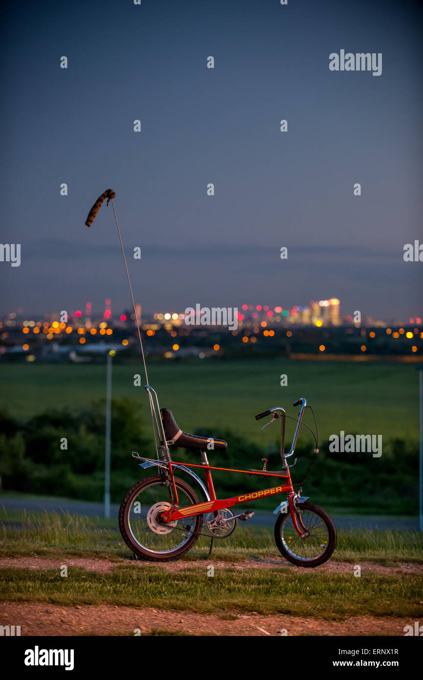 Raleigh Chopper Mark 2 in front of the skyline of London's docklands - Stock Image