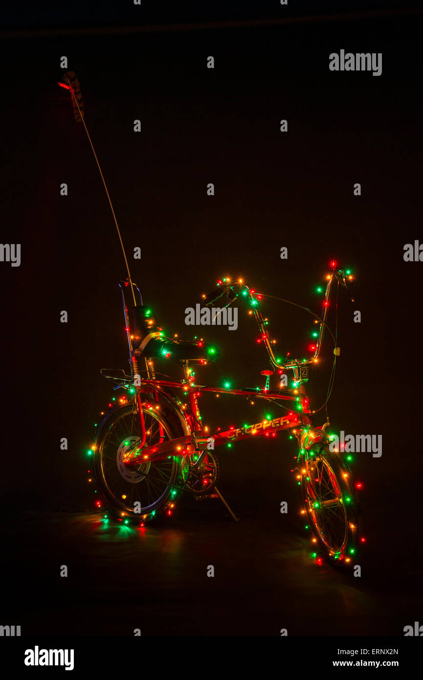 Original Raleigh Chopper Mark II decorated with Christmas lights. - Stock Image