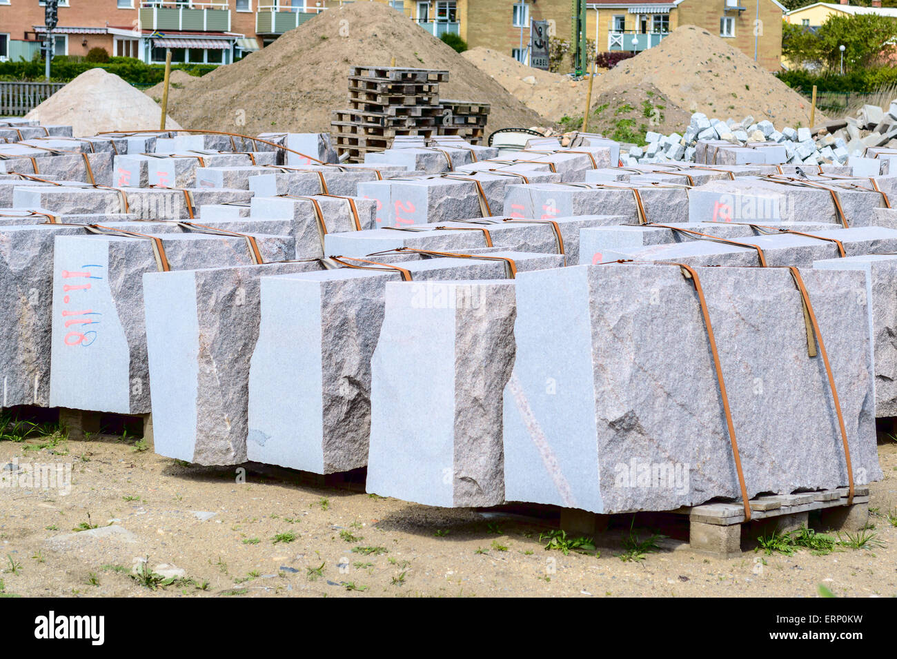 Large slabs of granite secured by belts on pallets. Every stone is ...