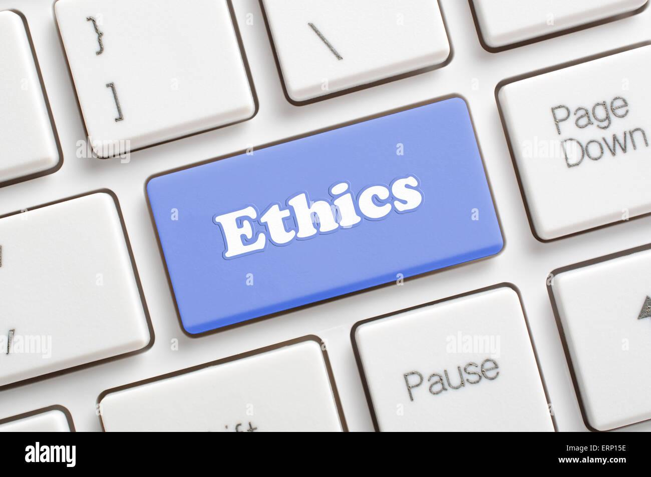 Blue ethics key on keyboard - Stock Image