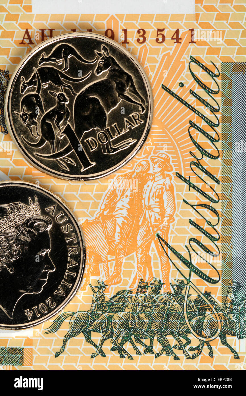 Australian One Dollar Coins on a One Hundred Dollar banknote.  Australian Currency. Australian Dollar. - Stock Image