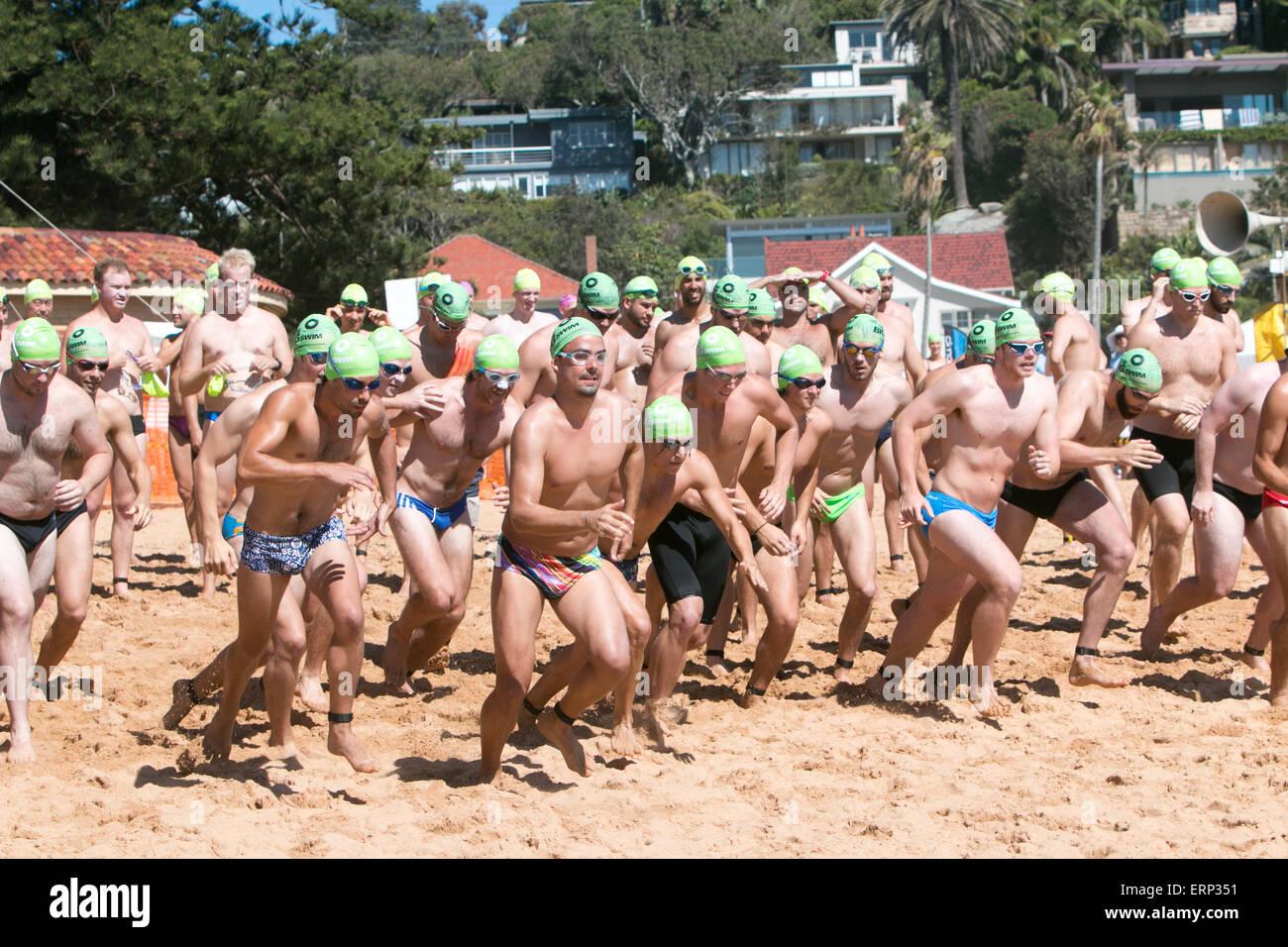 male competitors in the 41st Palm beach to whale beach big swim ocean swim,Sydney,Australia - Stock Image