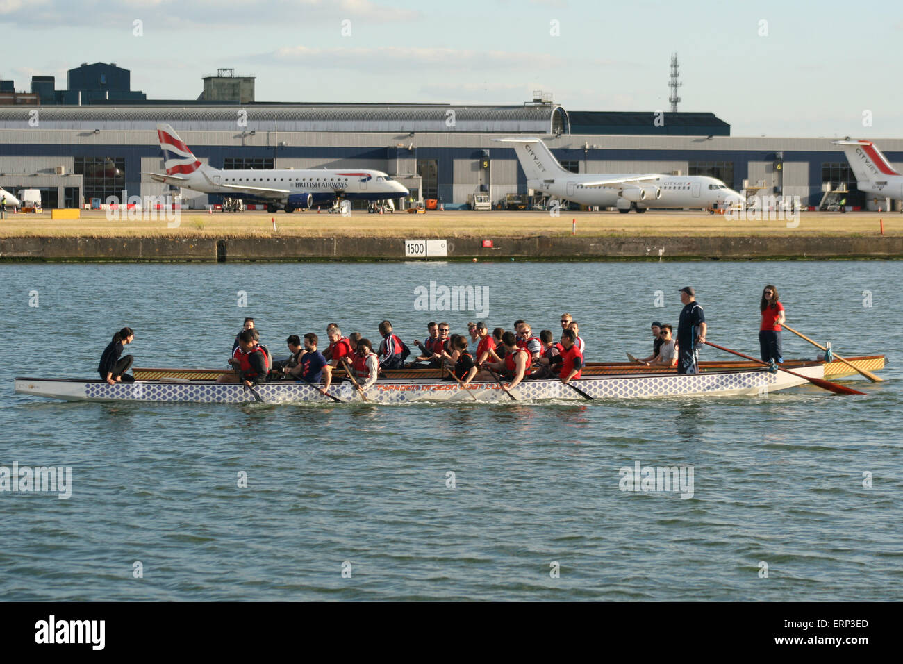 london city airport docklands boat rowing - Stock Image