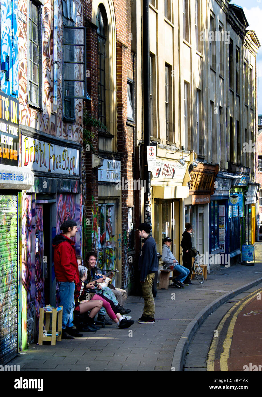 29 May 2015 - Bristol, UK : Early Friday Evening on Stokes Croft, a group gather outside the Bristol Free Shop - Stock Image