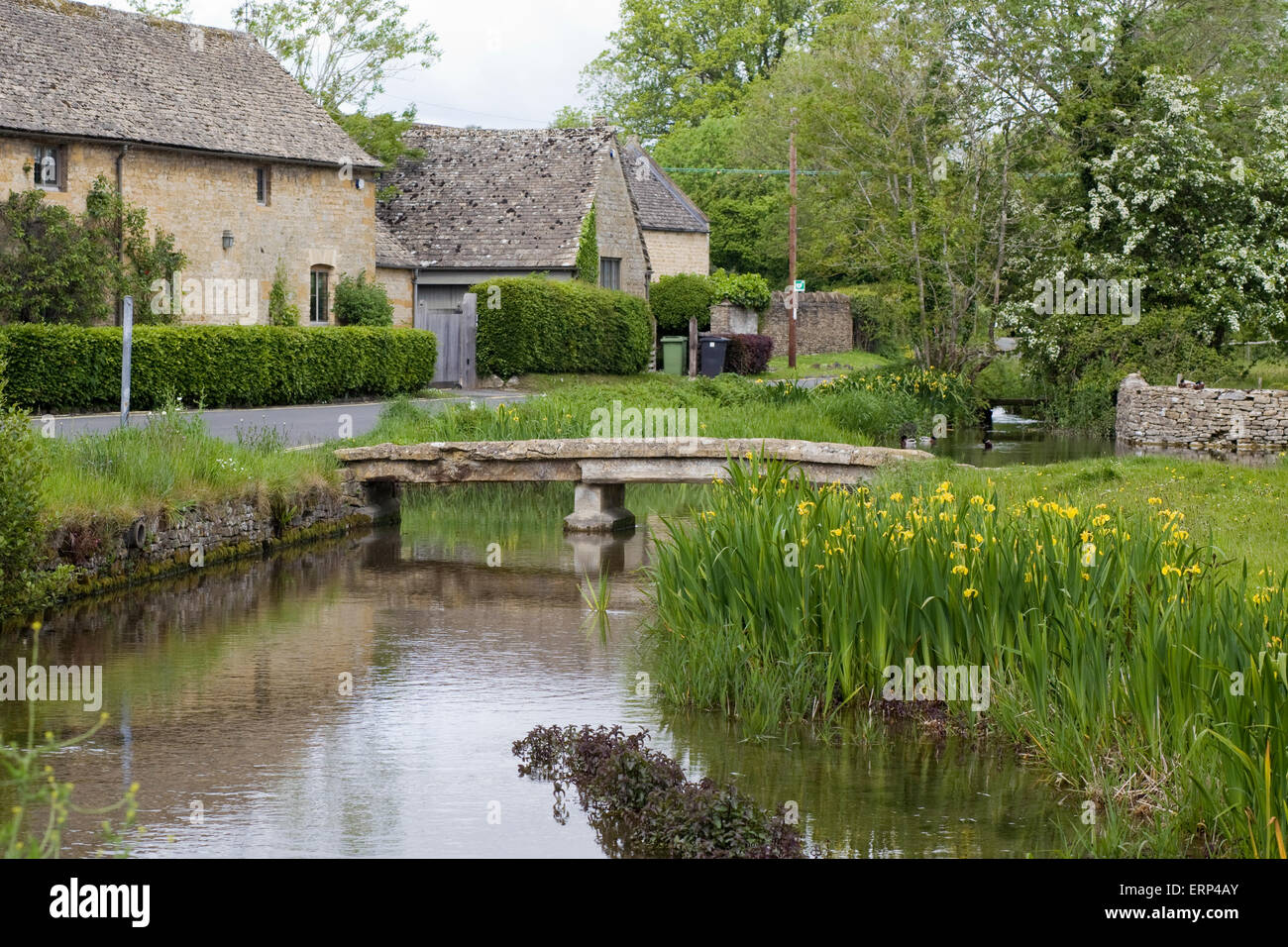 Stone cottages in Lower slaughter in the cotswolds - Stock Image