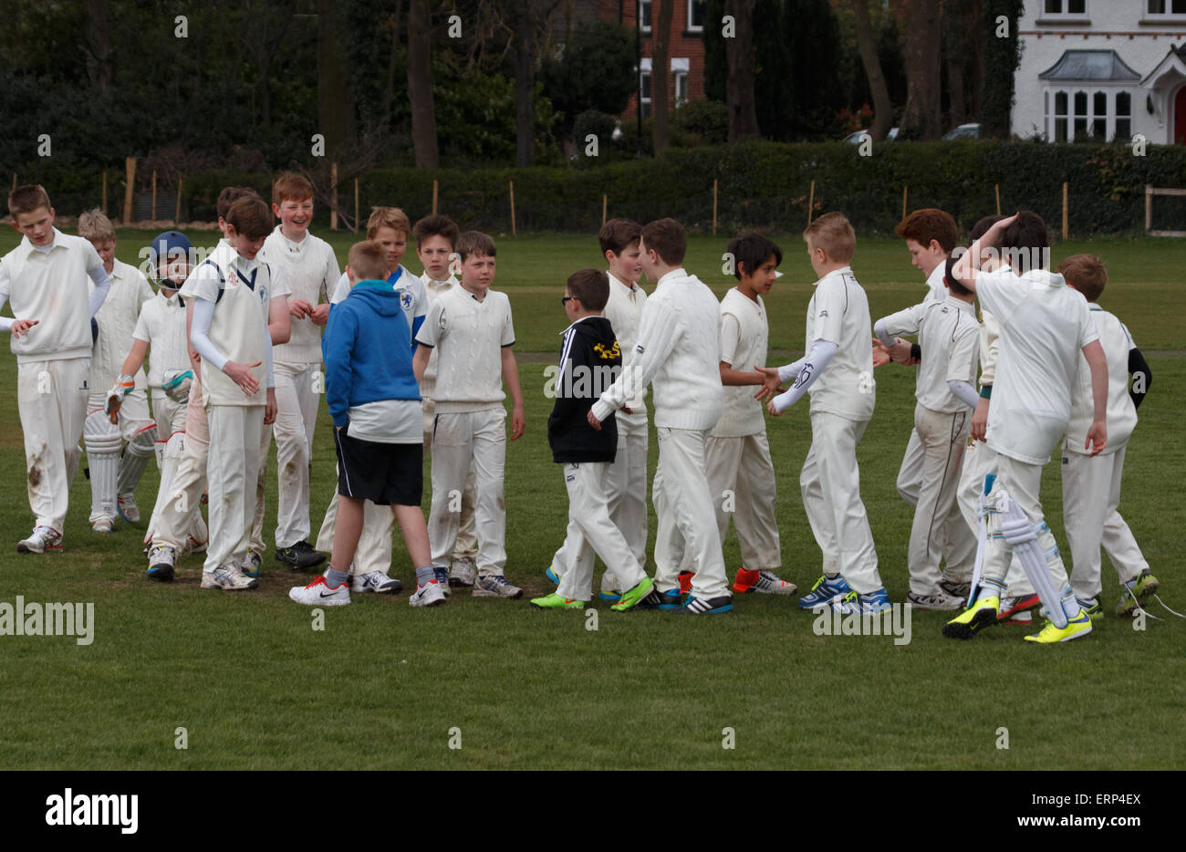 U13 boys cricket teams shaking hands with each other at the end of a match. - Stock Image