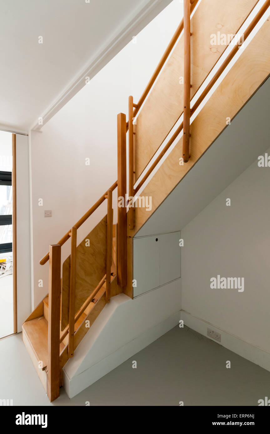 Detail of interior wooden staircase to flat on the Alexandra and Ainsworth estate in Camden, North West London. Stock Photo