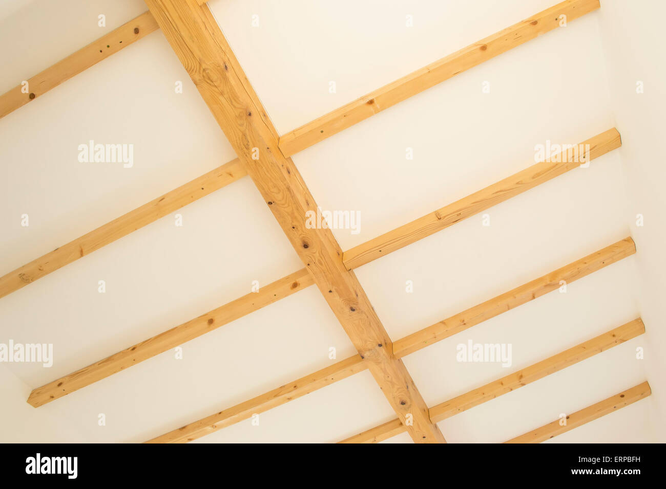 Roof with supportive wooden beams, main girder and parallel secondary beams - Stock Image