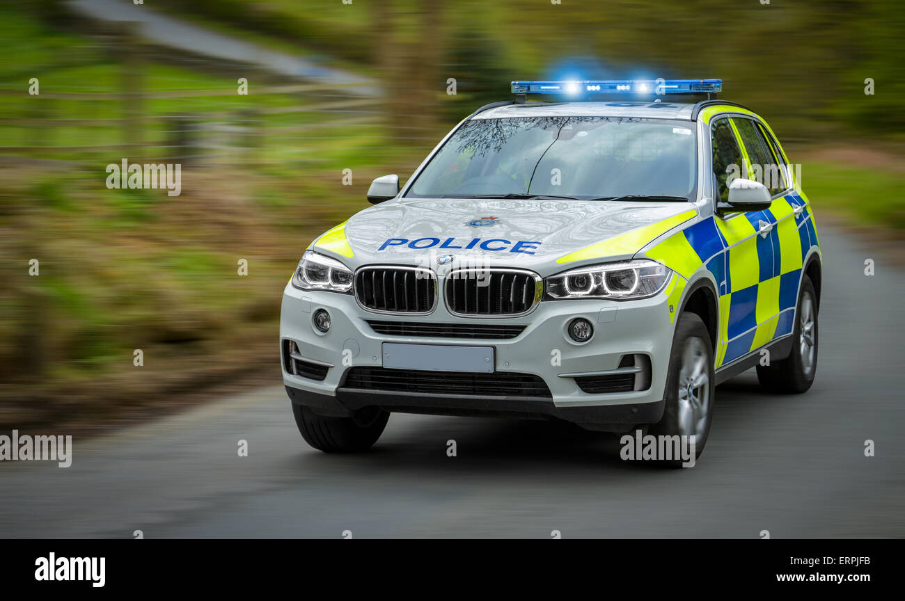 A police car speeds to an emergency. Stock Photo